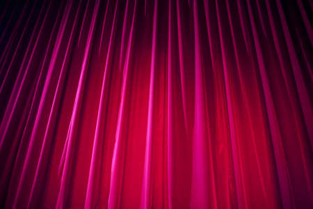 theatre: Theater curtain with dramatic lighting Stock Photo