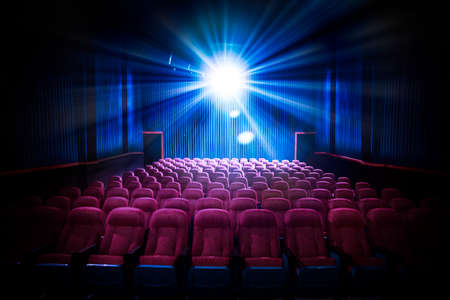 at the theater: Movie Theater with empty seats and projector  High contrast image Stock Photo