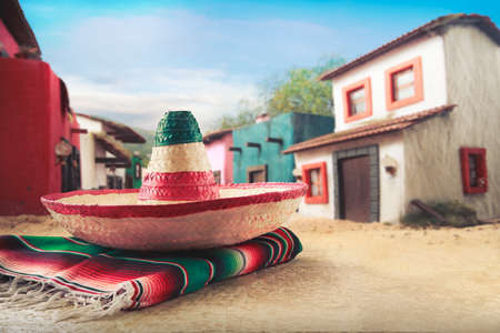 Mexican hat sombrero on a serape in a mexican town Stock Photo
