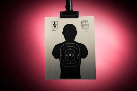 shooting target: Shooting target hanging on a red background Stock Photo