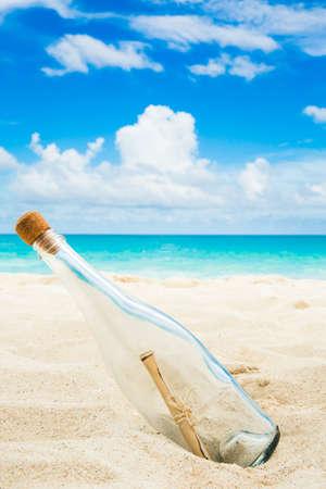 message in a bottle: Message in a bottle on a shore