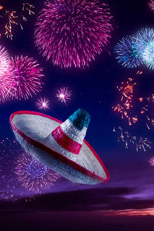 Mexican sombrero with fireworks at night