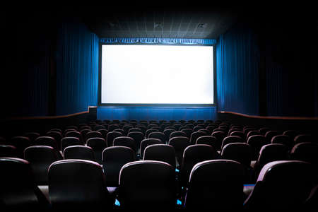 theatre performance: Movie Theater with blank screen  High contrast image