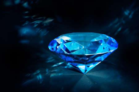 luxurious blue diamond shining on a black background