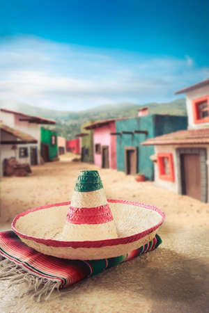 serape: Mexican hat sombrero on a serape in a mexican town Stock Photo