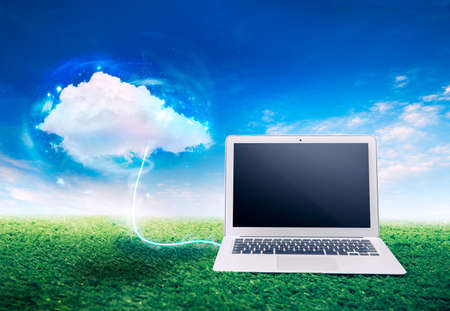 laptop on grass, cloud computing concept