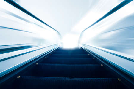 Empty escalator going up with motion blur