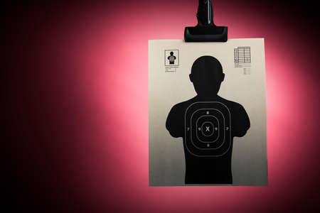 Shooting target hanging on a red background Stock Photo