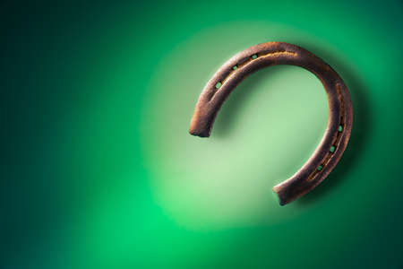 Horse shoe on a green background Stock Photo