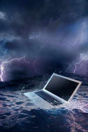 data recovery: laptop on water damaged computer Stock Photo