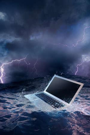 hard drive crash: laptop on water damaged computer Stock Photo