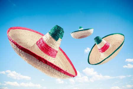 mexican culture: Mexican sombreros in a blue sky