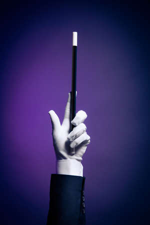 illusionist: Magician hand with magic wand