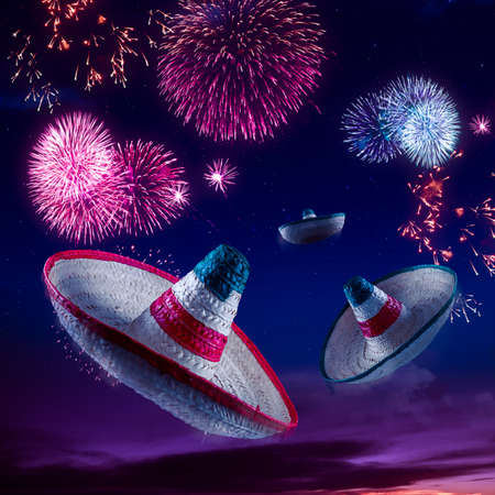 mexico culture: Mexican sombreros with fireworks at night