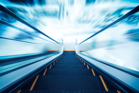 going down: Empty escalator going down with motion blur