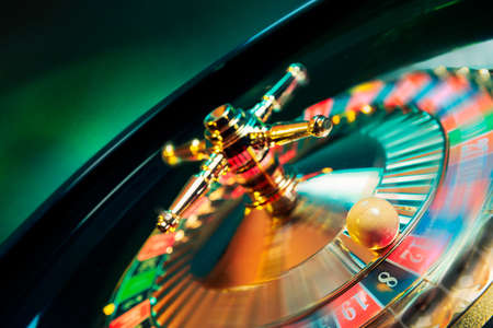 roulette wheel: high contrast image of casino roulette in motion Stock Photo