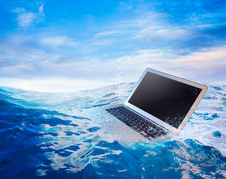 disaster recovery: laptop on water damaged computer Stock Photo