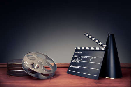 cinema strip: movie industry objects on a grey background