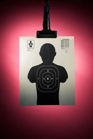 sniper training: Shooting target hanging on a red background Stock Photo