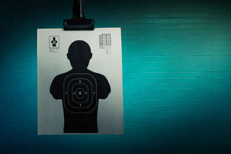 Shooting target hanging on a grungy background Imagens