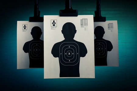 shooting gun: Shooting targets hanging on a grungy background