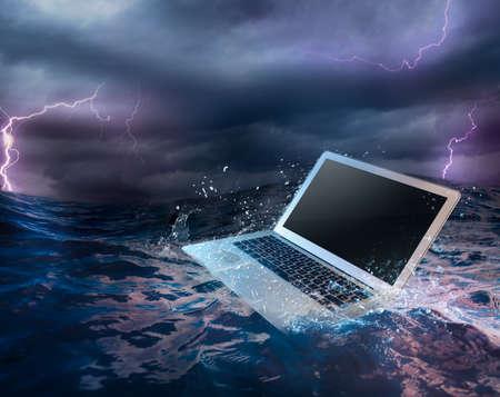 damage: laptop on water damaged computer Stock Photo