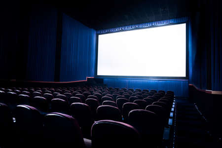 movie theatre: Movie Theater with blank screen  High contrast image