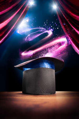 illusionist: photo composite of a magic hat on a stage