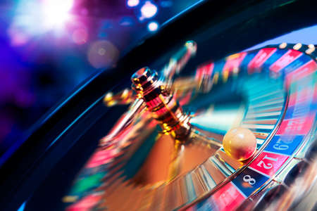 spinning wheel: high contrast image of casino roulette in motion Stock Photo