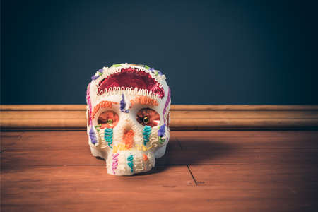 High contrast image of sugar skull used for dia de los muertos celebration in a grey background Stock Photo