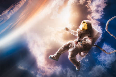 stratosphere: Astronaut floating in the stratosphere near a planet