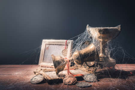 cobwebs: High contrast image of dusty trophies with cobwebs representing broken or abandoned dreams Stock Photo