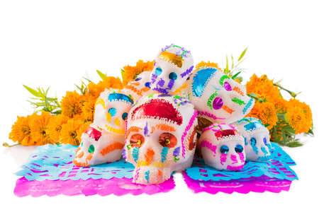 sugar skulls used for dia de los muertos celebration isolated on white with cempasuchil flowers Banco de Imagens