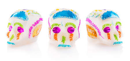 holiday tradition: High contrast image of sugar skulls used for dia de los muertos celebration isolated on white