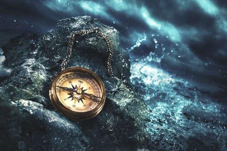 high contrast image of a compass on rocks Zdjęcie Seryjne - 64141574