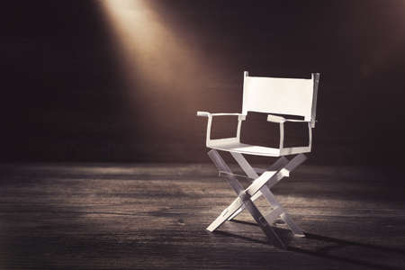 High contrast image of director chair made of paper  selective focus Stockfoto