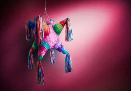 pinata: Colorful mexican pinata used in birthdays on red background Stock Photo