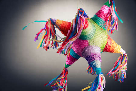 ata: Colorful mexican pinata used in birthdays on a grey background Stock Photo