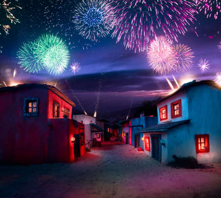 scale model of a mexican town at twlight with fireworks
