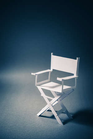 High contrast image of director chair made of paper Stock fotó
