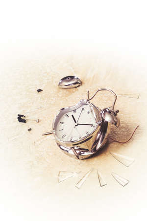 irritating: destroyed alarm clock on the floor  copy space, high key image