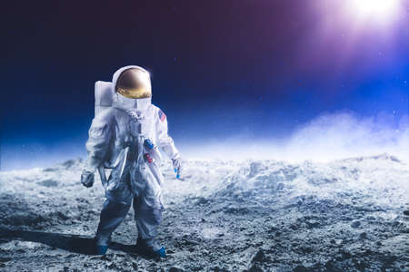 Astronaut standing on the moon Stock Photo - 64144094
