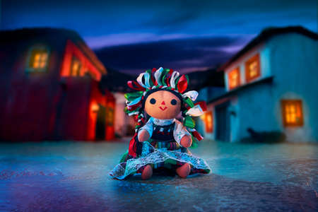mexican dress: Mexican rag doll in a traditional dress at night Stock Photo