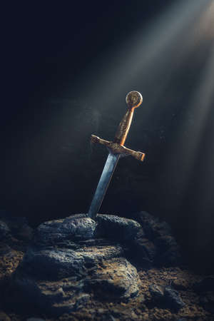 High contrast image of Excalibur, sword in the stone Фото со стока