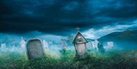 Panorama view of graveyard with fog with dramatic lighting Stock Photo