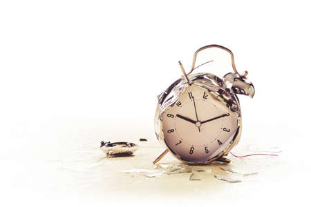 destroyed alarm clock on the floor / copy space, high key image