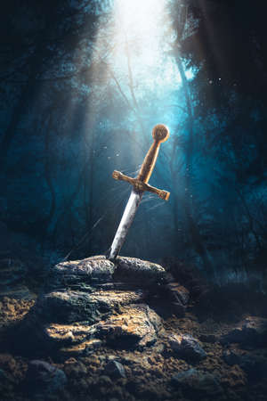 High contrast image of Excalibur, sword in the stone with light rays and dust specs in a dark forest