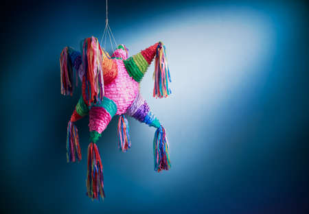 pinata: Colorful mexican pinata used in birthdays on a blue background