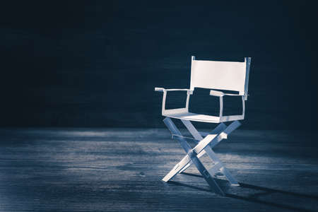 filmmaker: High contrast image of director chair made of paper Stock Photo