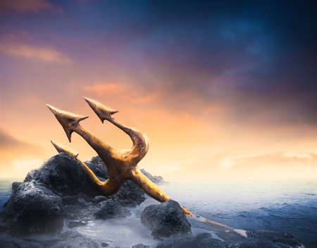 High contrast imgae of Poseidon's trident resting on some rocks by the sea